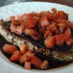 Seared pepper crusted tuna with tomatoes and balsamic glaze